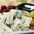 Blue cheese with grapes and nuts — Stock Photo #12813681