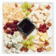 Blue cheese with grapes and nuts — Stock Photo #12813707