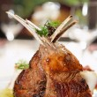 Raw rack of lamb fried with herbs and spices - Stock Photo