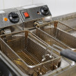 Deep fryer n restaurant kitchen — Stock Photo #12815416