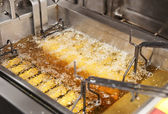 Deep fryer with oil on restaurant kitchen — Stock Photo
