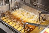 Deep fryer with oil on restaurant kitchen — Stock Photo