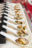 Spoons with mussels — Stock Photo