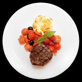 Tasty steak isolated on black — Stock Photo