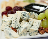 Blue cheese with grapes and nuts — Stock Photo