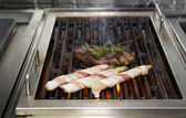 Meat and bacon on grill — Stock Photo