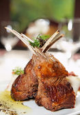 Raw rack of lamb fried with herbs and spices — Stock Photo