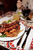 Grilled pork ribs, beef and shrimps — Stock Photo