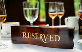Reserved plate on a restaurant table — Stock Photo