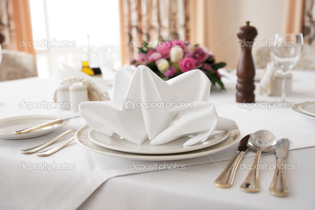 Place setting in an expensive haute cuisine restaurant  Stock Photo #12814294