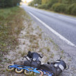 Rollerskates on roadside - friendly transport - Stock Photo
