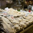 Barcelona fish market - stall with frozen fish fillet — Stock Photo #13176530
