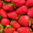 Strawberry background - tasty but risky — Stock Photo