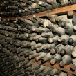 Cellar full of dirty wine bottles — Stock Photo #13177993