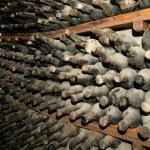 Cellar full of dirty wine bottles — Stock Photo #13177993