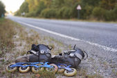 Rollerskates on roadside - environmet friendly transport — Stock Photo
