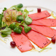 Tuna carpaccio on plate - Stock Photo