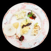 Cheese plate with fruits and nuts — Stock Photo