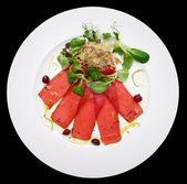 Tuna carpaccio on plate — Stock Photo