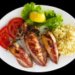 Grilled stuffed squids with rice - Stock Photo