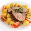 Rack of lamb with fried potatoes isolated on white — Stock Photo