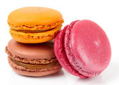 Three colorful macarons on white background — Stock Photo
