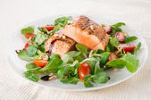 Rare fried salmon steaks in plate — Stock Photo