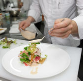 Chef is cooking appetizer — Stock Photo