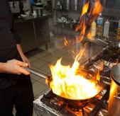 Chef is making flambe dish — Stock Photo
