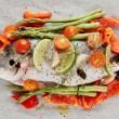 Dorade with vegetables prepared for roasting — Stockfoto #20537945