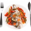 Roasted gilt-head bream with vegetables on plate, isolated on wh — Stock Photo