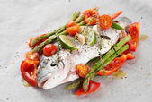 Dorade with vegetables prepared for roasting — Stock Photo