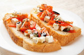 Homemade bread with feta cheese in plate — Stock Photo