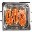 Salmon steaks in grill pready for cooking, isolated — Stockfoto #20557505