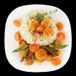 Risotto with pan seared sea scallops isolated on black — Stock Photo #20560731