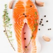 Salmon steak, garlic, black pepper and thyme — Stock Photo