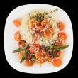 Risotto with pan seared sea scallops isolated on black — Stock Photo #20562101