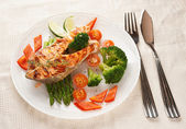 Grilled salmon steaks in plate — Stock Photo