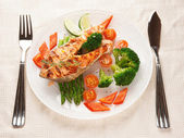 Grilled salmon steaks in plate on table — Stock Photo