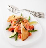 Salmon carpaccio on light grey surface — Stock Photo