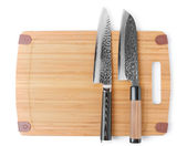 Two expensive japanese knives on cutting board — Stock Photo
