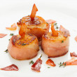 Stock Photo: Scallops wrapped in bacon and seared