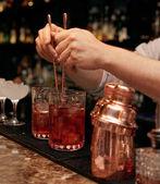 Bartender is stirring cocktails — Stock Photo