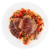 Ribeye steak with fried vegetables isolated on white — Stock Photo