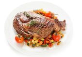 Ribeye steak with stir fried vegetables isolated on white — Stock Photo