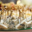 Variety of cheese on banquet table — Stock Photo