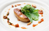 Fried foie gras with caramelized nuts and vegetables — Stock Photo