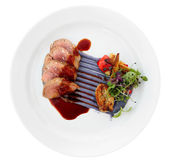 Veal fillet with violet botato mash, sweetbread and grilled vege — Stock Photo