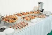 Various snacks on banquet table — Stock Photo