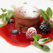 Chocolate fondant with berry sauce — Stock Photo